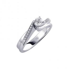 Δαχτυλίδι μονόπετρο με μπριγιάν, από λευκόχρυσο 18 καρατίων. Το κεντρικό διαμάντι 0,10ct.